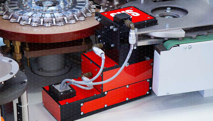 Quality Control Vision System for crown screw caps integrated into SACMI lining machines